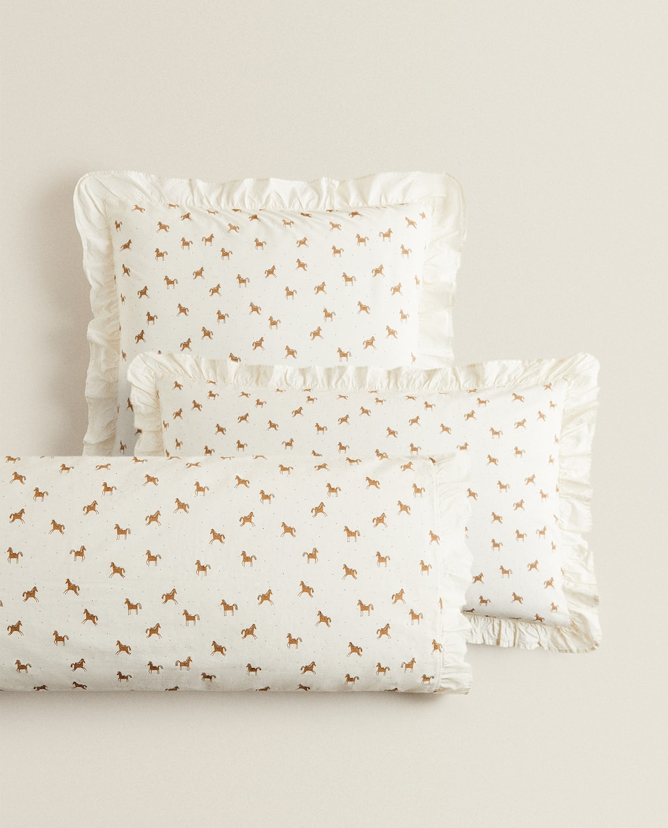 PILLOWCASE WITH HORSE PRINT AND RUFFLE