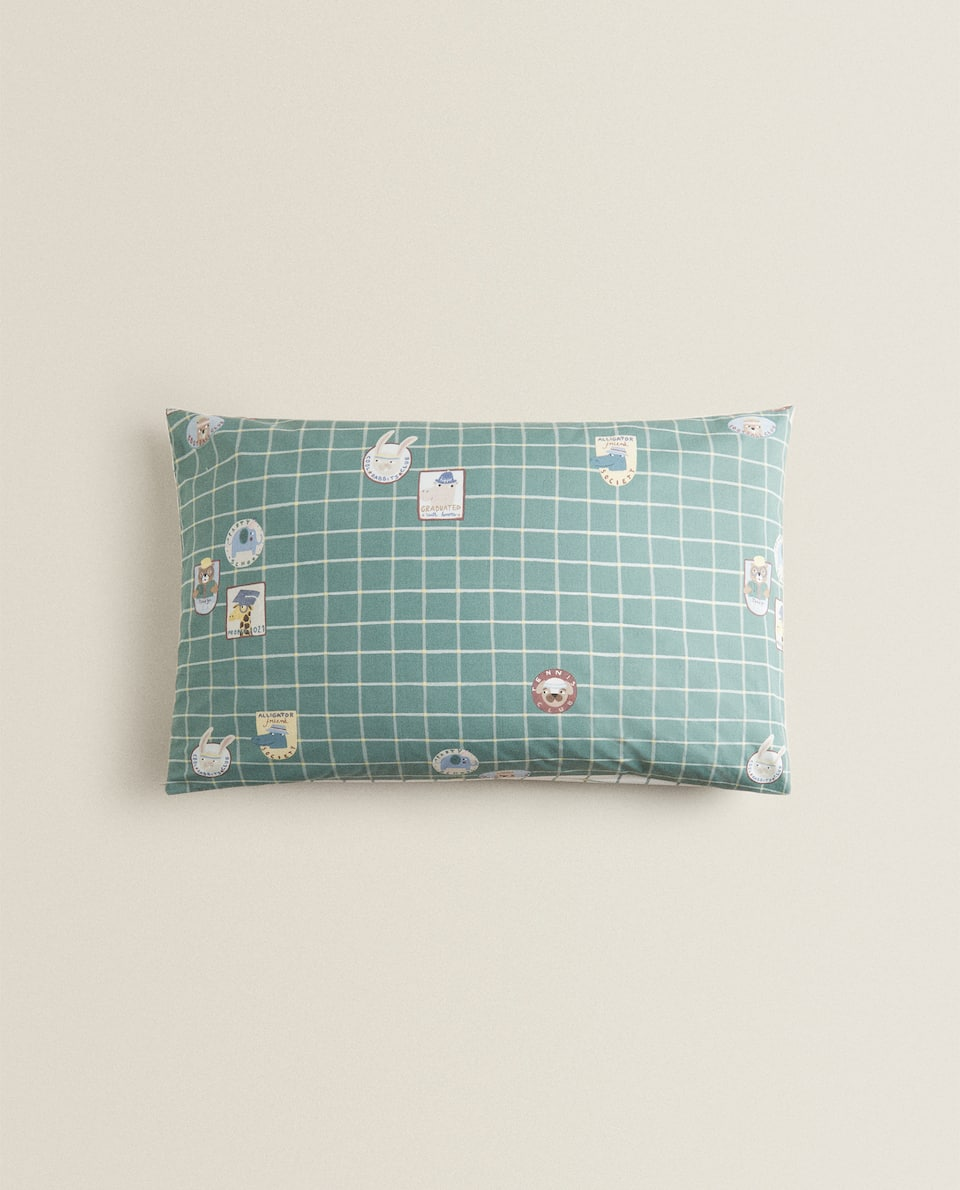 REVERSIBLE CHECK AND PATCH PILLOWCASE