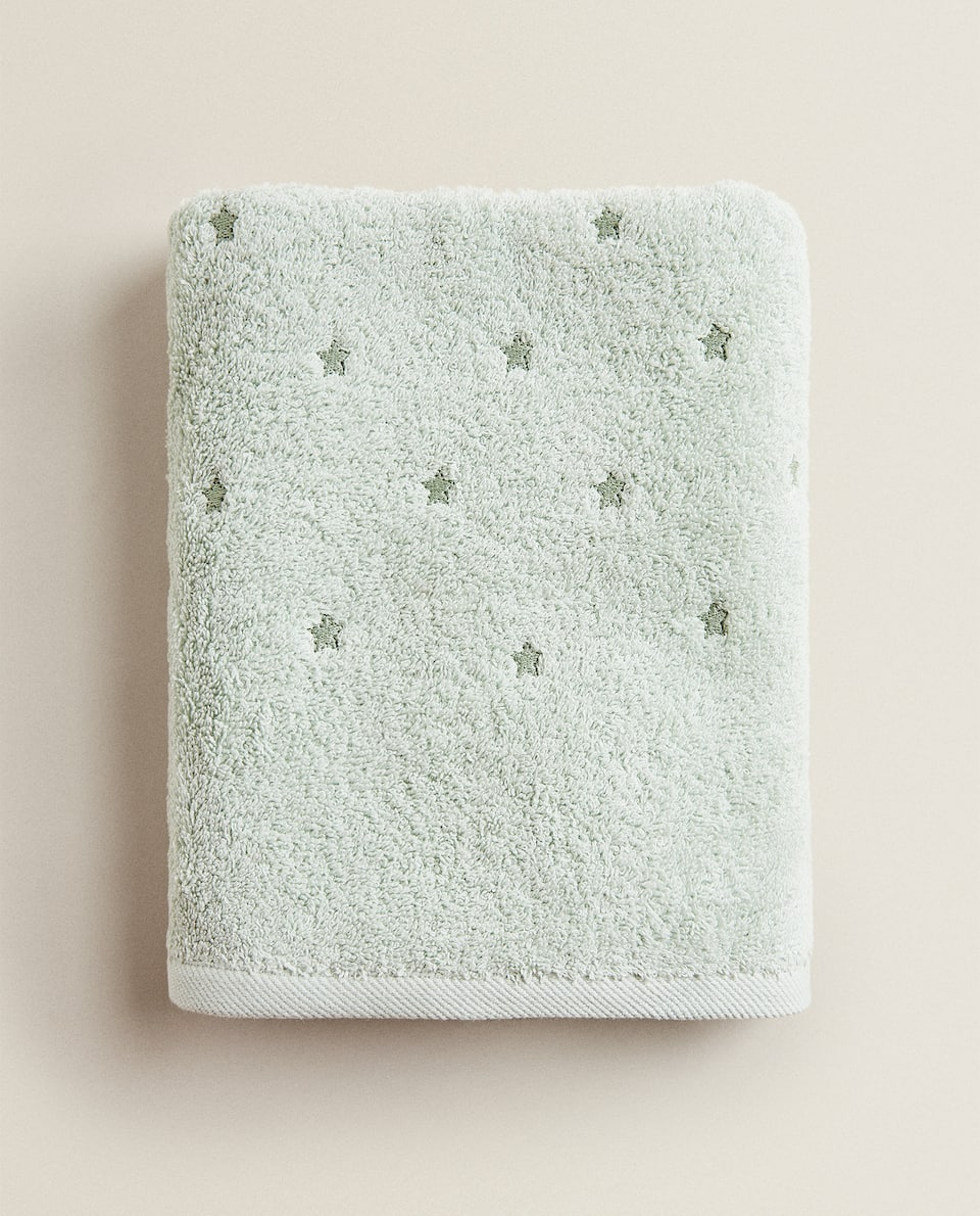 EMBROIDERED STAR AND TASSEL TOWEL