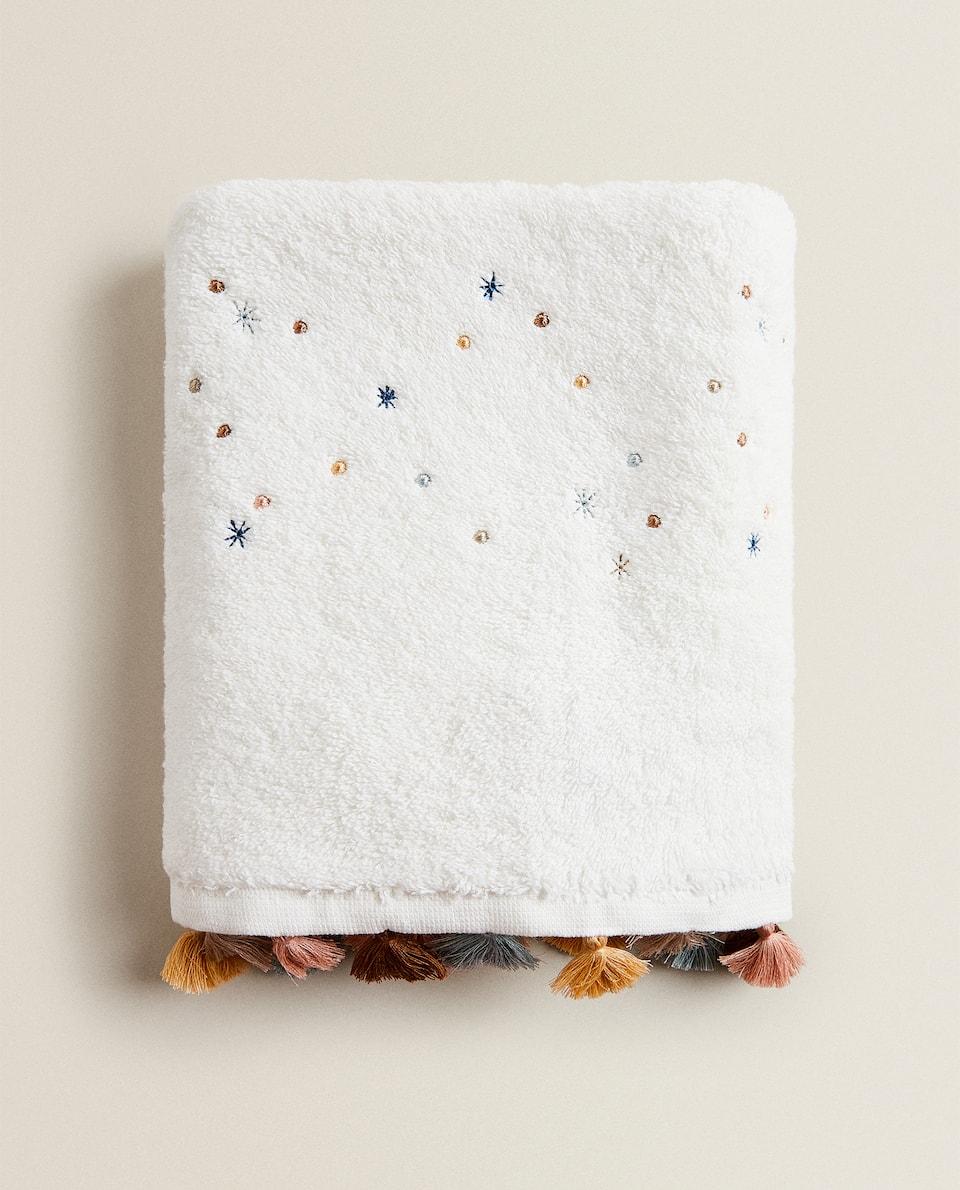 MULTICOLOURED STAR AND TASSEL TOWEL