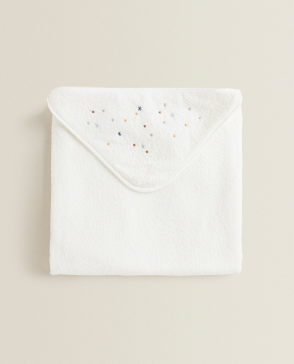 HOODED TOWEL WITH MULTICOLOURED STARS