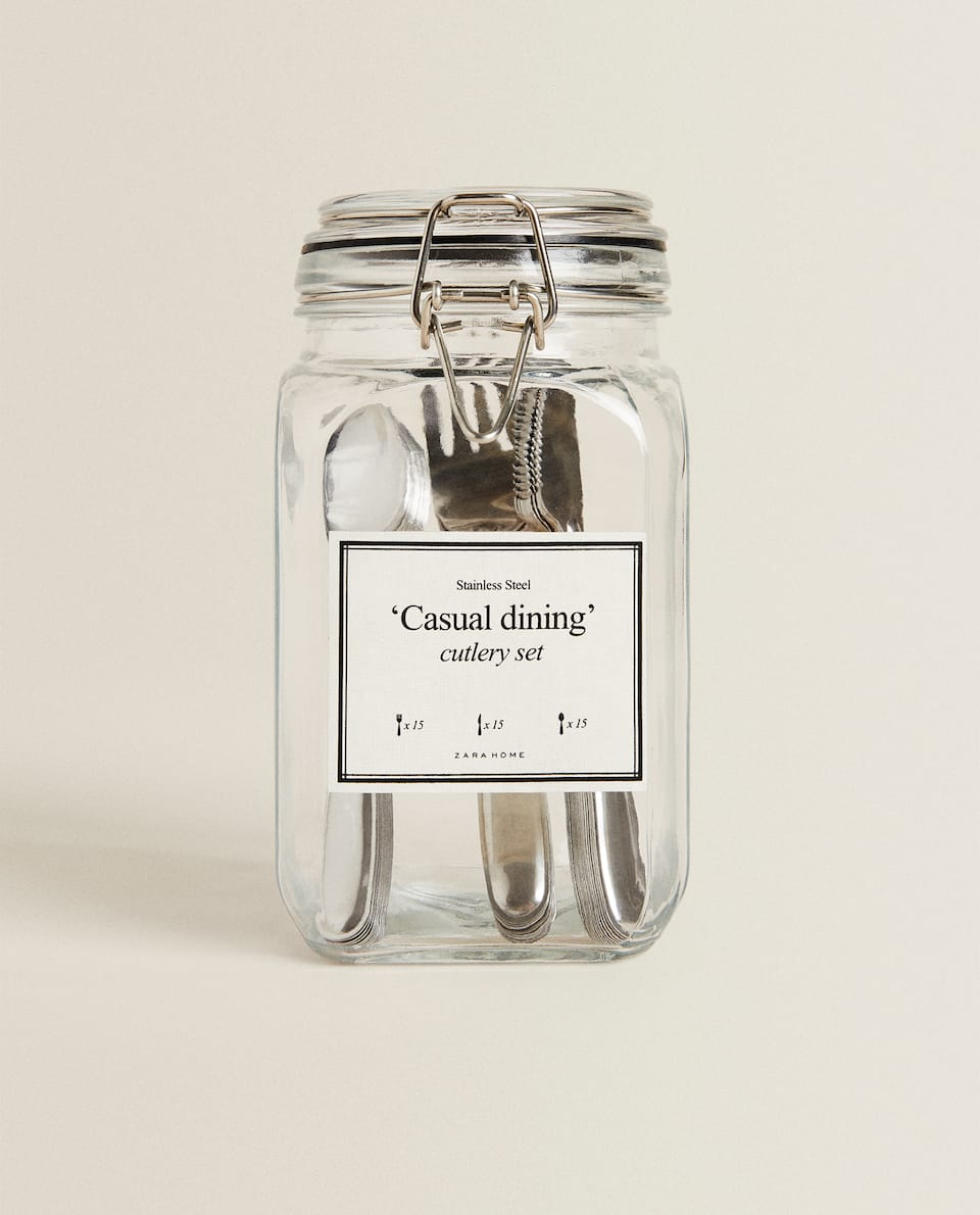 SET OF 45 PIECES OF CULTLERY IN GLASS JAR