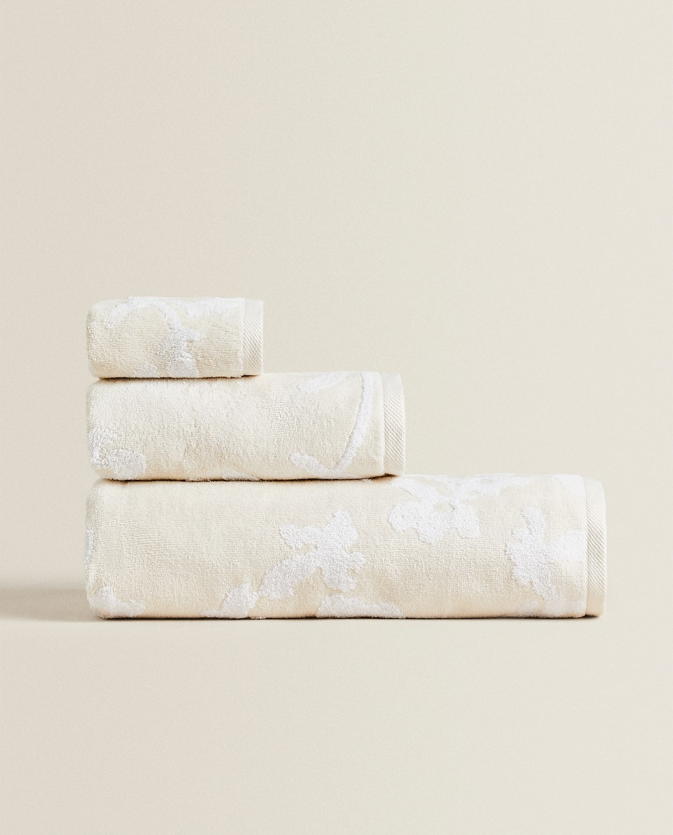 TOWEL WITH RAISED FLORAL DESIGN