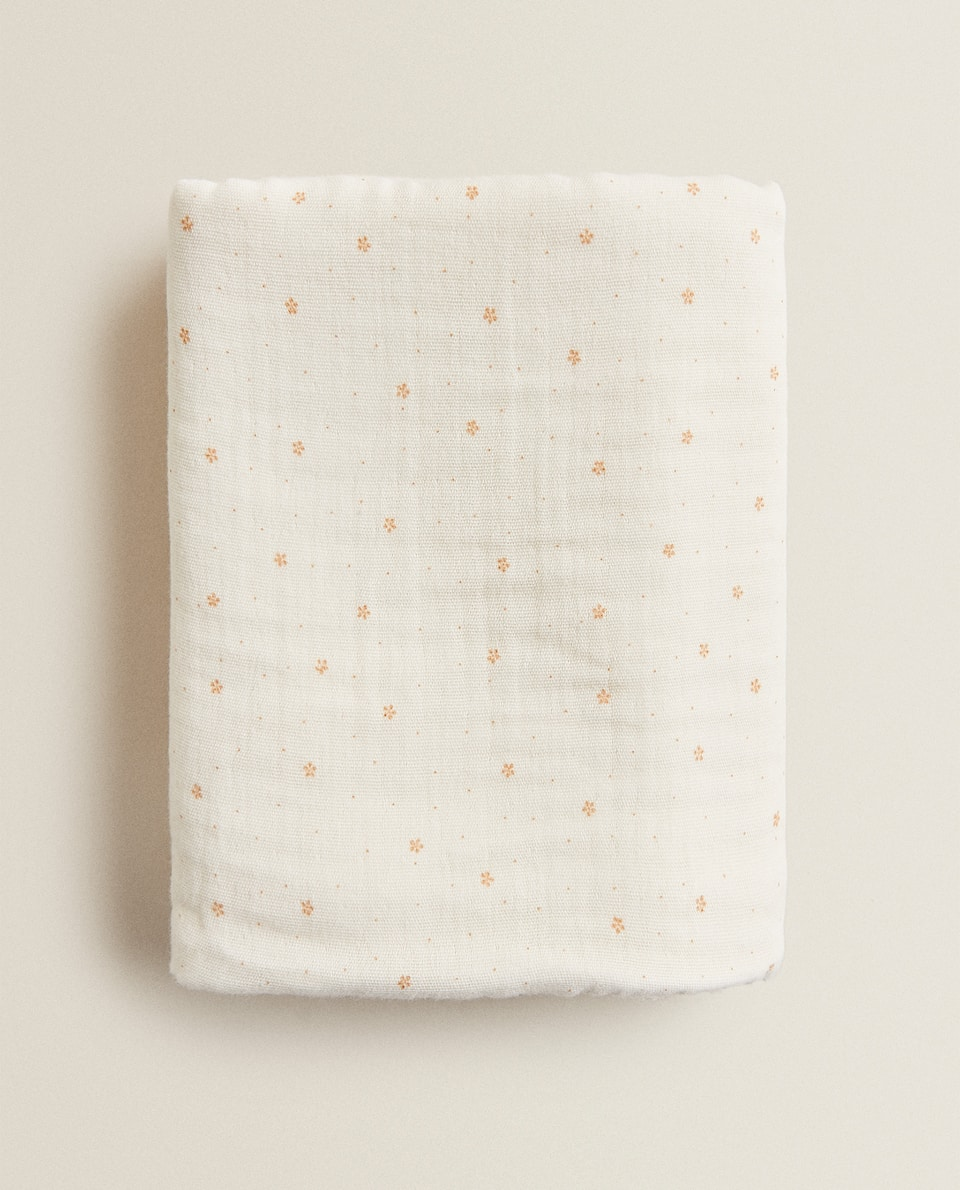 DOUBLE-SIDED TOWEL WITH MINI FLORAL PRINT