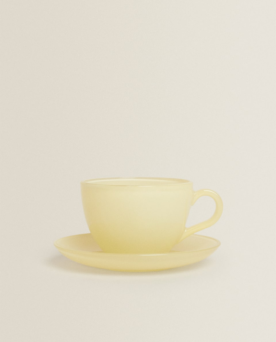 PASTEL-COLOURED GLASS COFFEE CUP AND SAUCER