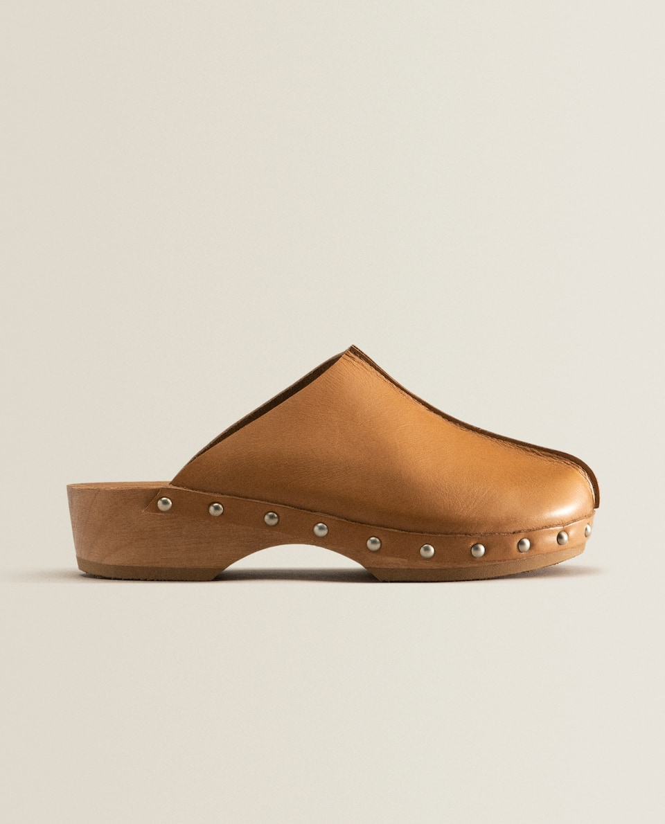 Leather and wood clogs