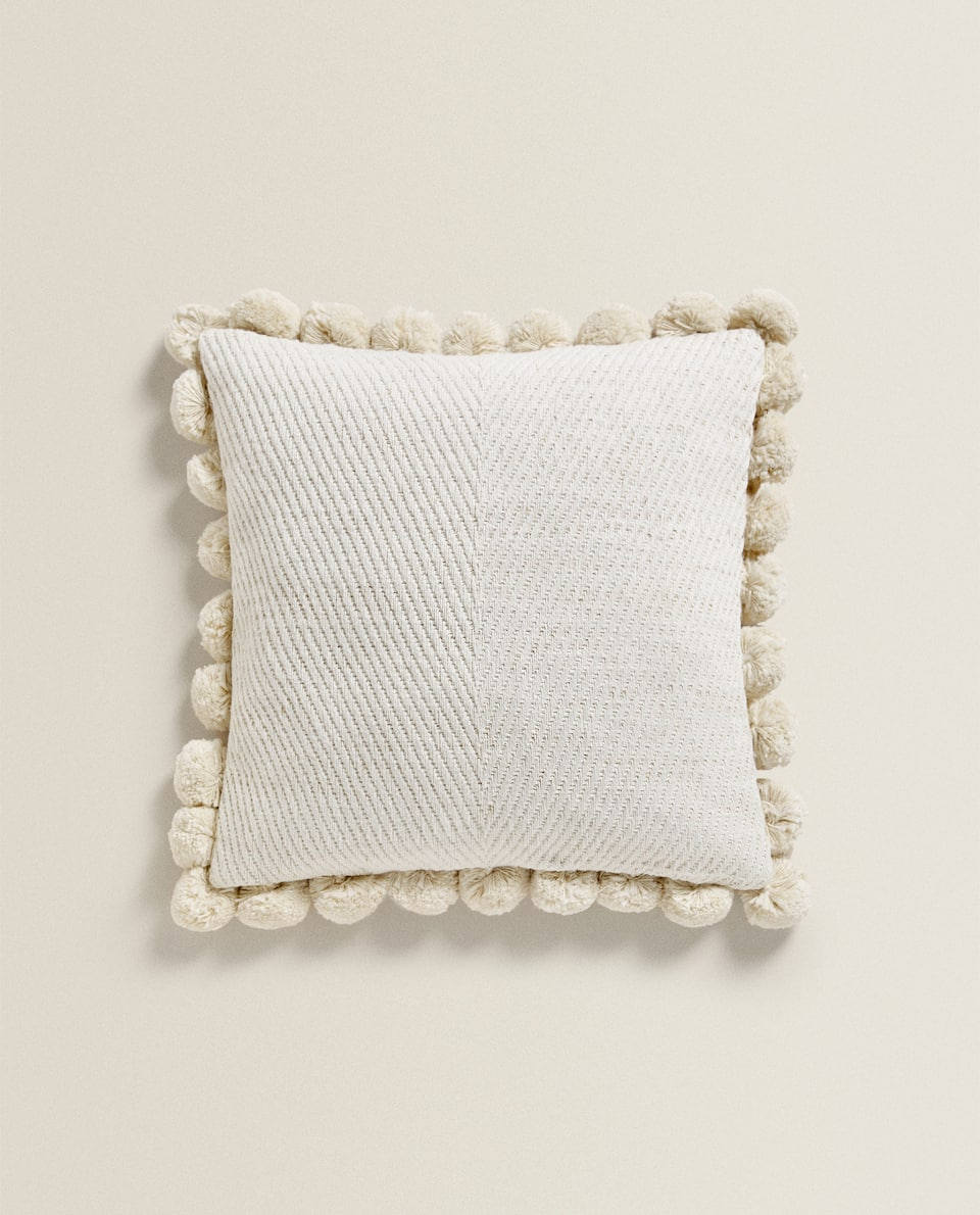 CUSHION COVER WITH POMPOMS