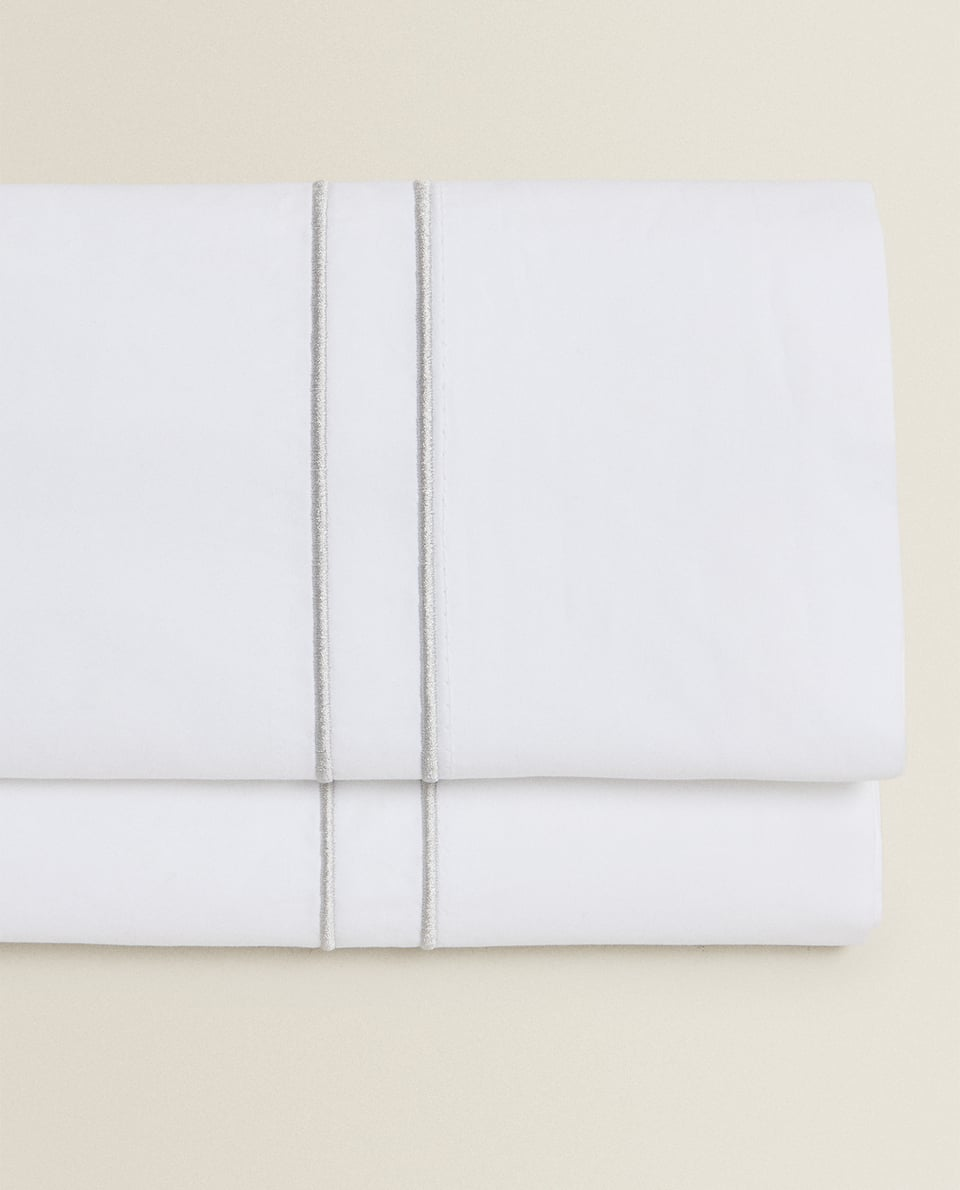 FLAT SHEET WITH TWO EMBROIDERED DETAILS