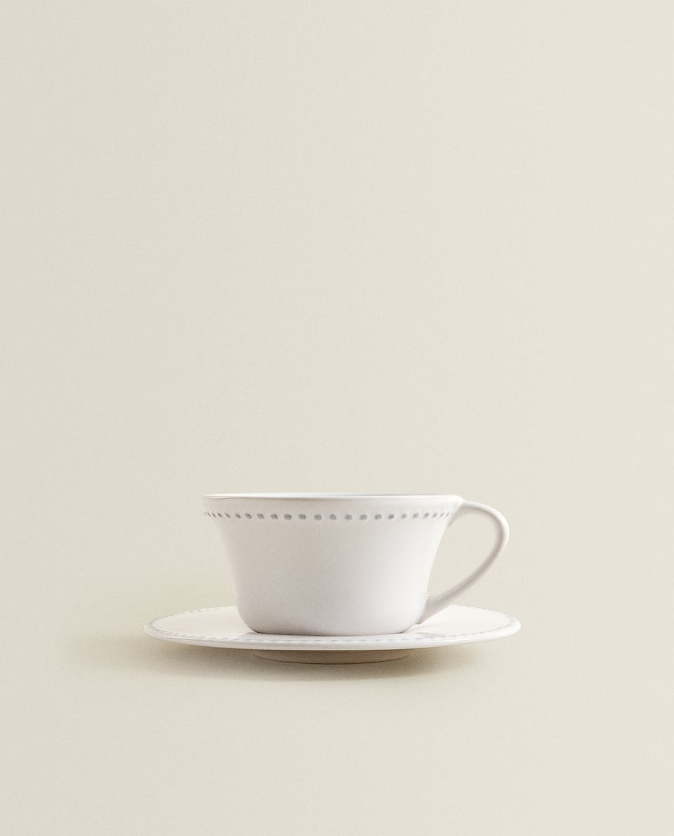 EARTHENWARE BREAKFAST CUP AND SAUCER WITH RAISED-DESIGN EDGE