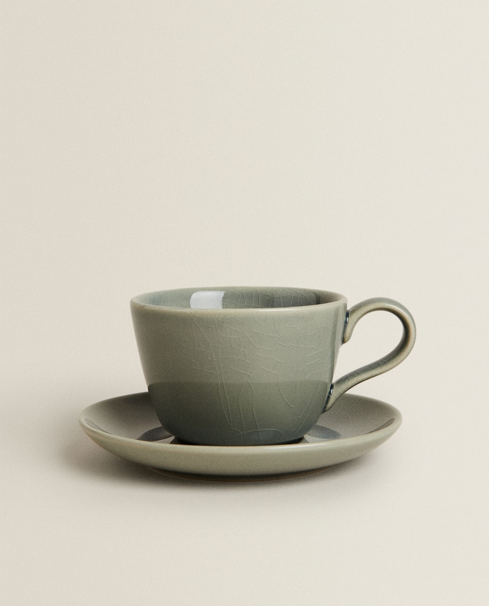 GLAZED STONEWARE TEACUP AND SAUCER