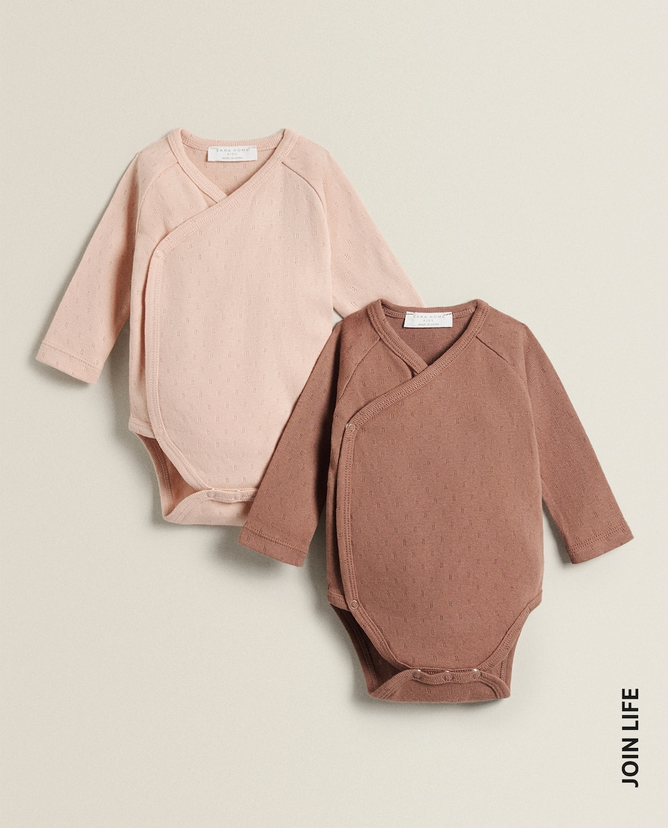 CROSSOVER BODYSUITS (PACK OF 2)