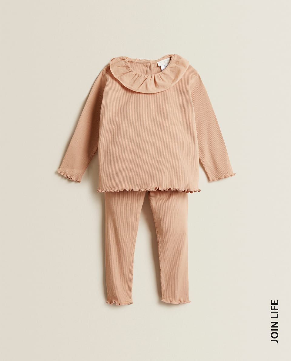 PYJAMAS WITH RUFFLED NECKLINE