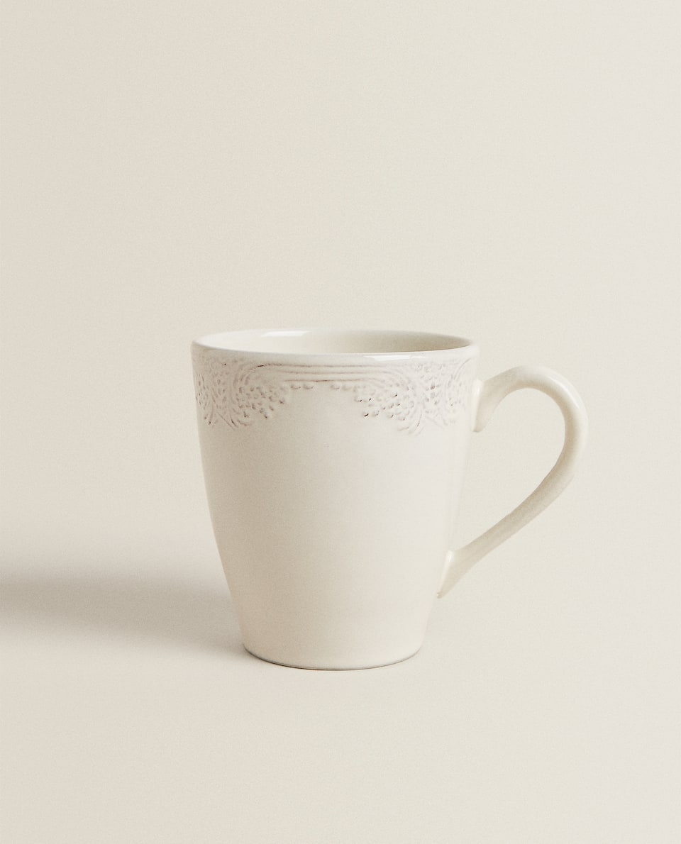 STONEWARE MUG WITH RAISED DESIGN