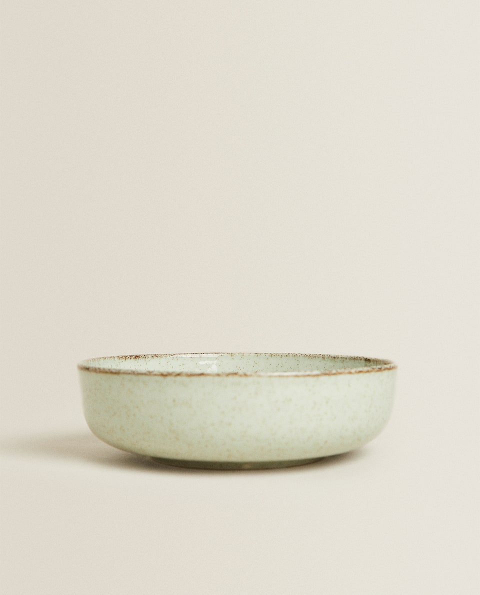 PORCELAIN BOWL WITH ANTIQUE FINISH RIM