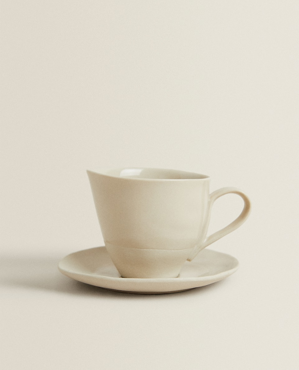 IRREGULAR PORCELAIN CUP AND SAUCER