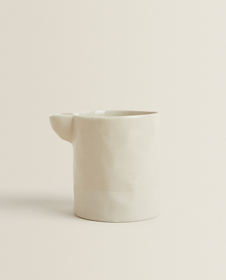 IRREGULAR PORCELAIN MILK JUG