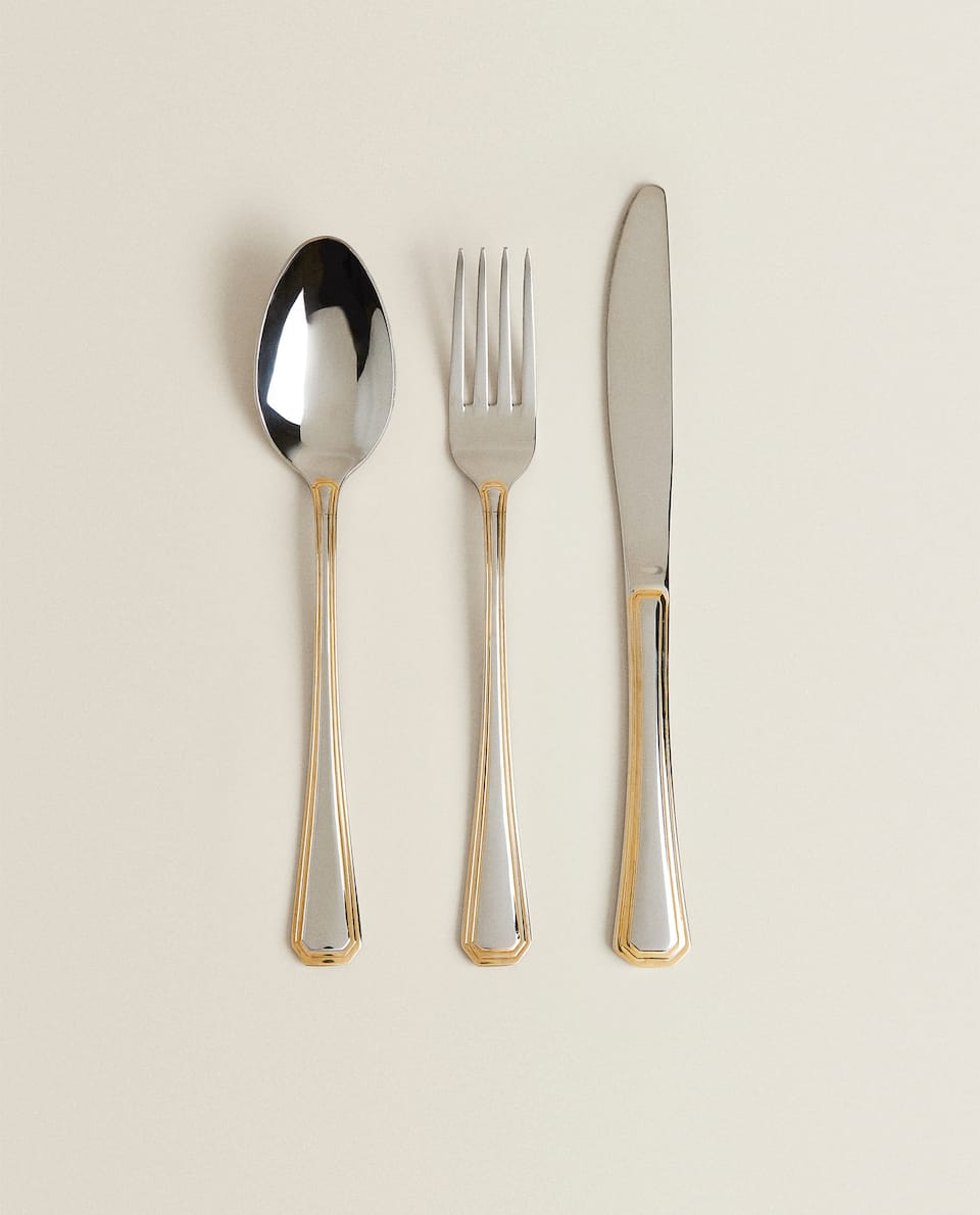 BOX OF 3 CUTLERY PIECES WITH GOLD RIM