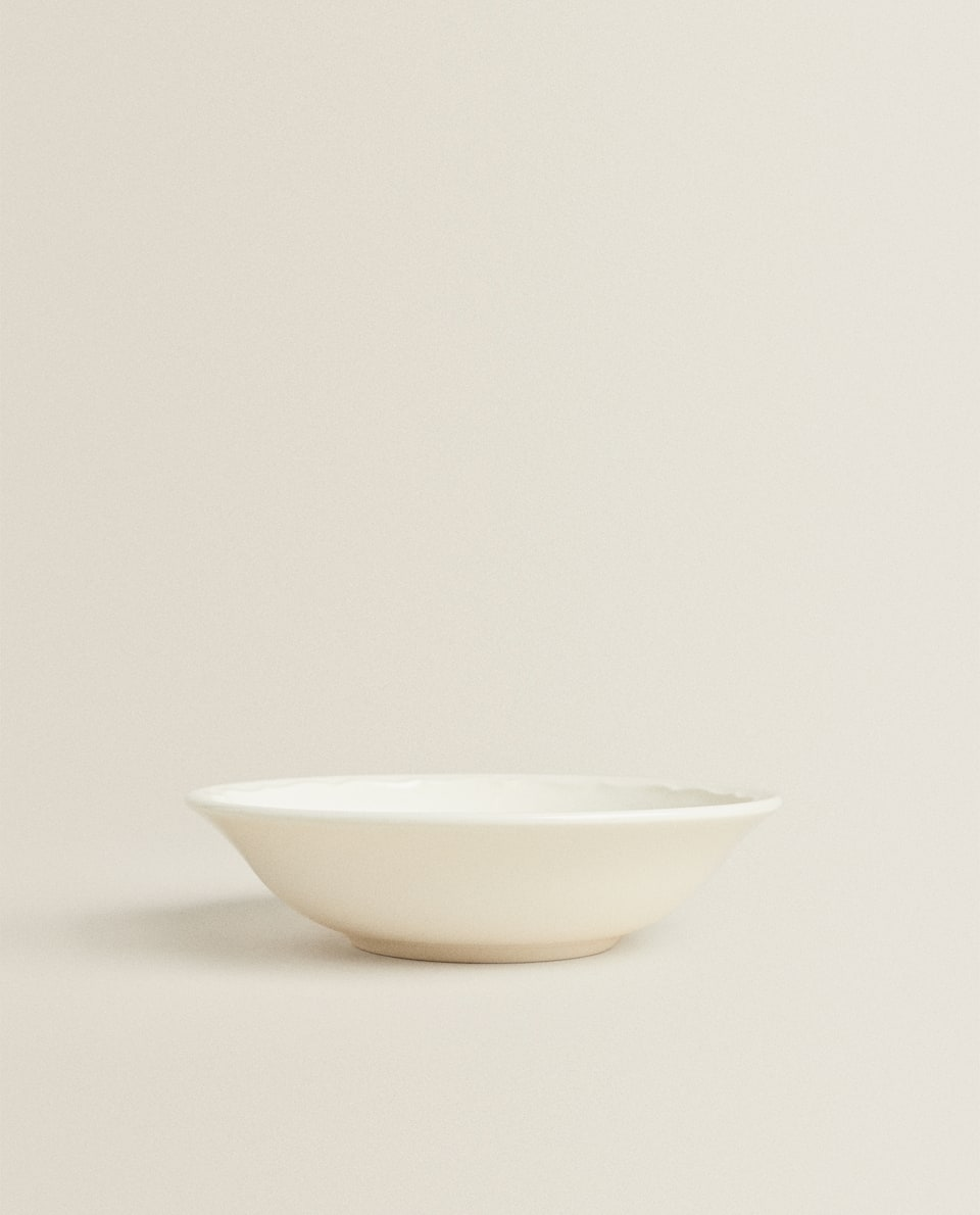 EARTHENWARE BOWL WITH A RAISED-DESIGN EDGE