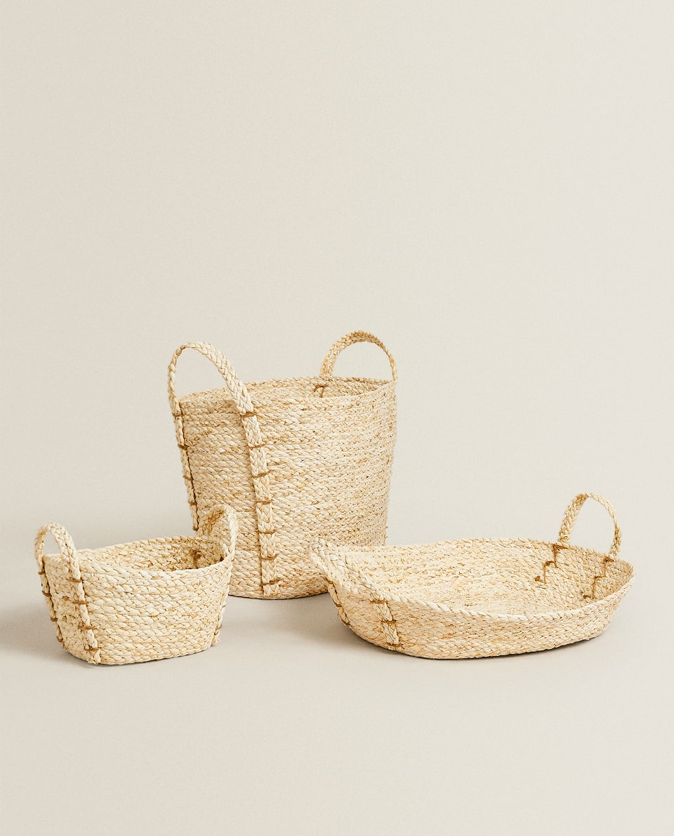 PLAITED BASKET WITH HANDLES