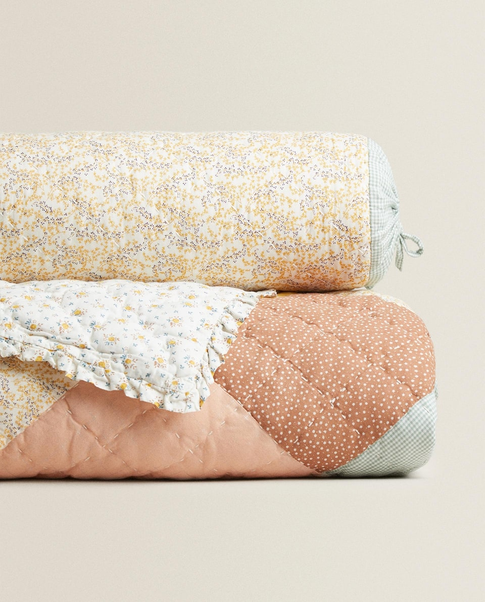 PATCHWORK QUILT WITH RUFFLE TRIM